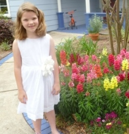 little-girl-with-flu-near-flowers