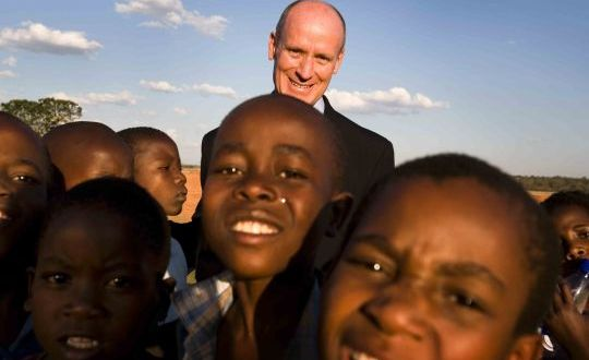 Dr. Mark Kline with kids in Africa