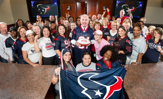 Texas Children's CEO and staff cheering for the Texans