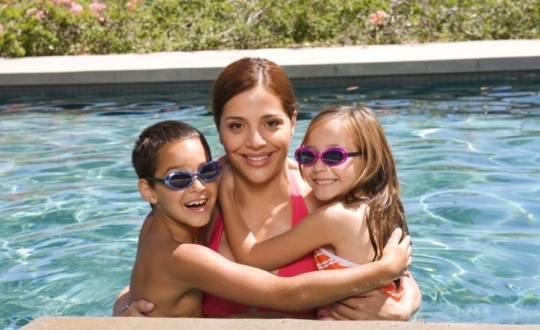 Mother and children at swimming pool