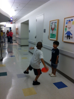 Playing in hallways at Cancer Center