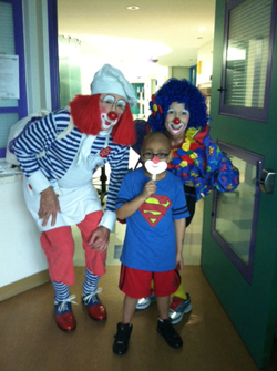 Playing with clowns at Unit Carnival in Cancer Center