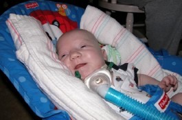 John flashes a smile during his lengthy stay at the Texas Children's NICU in 2005